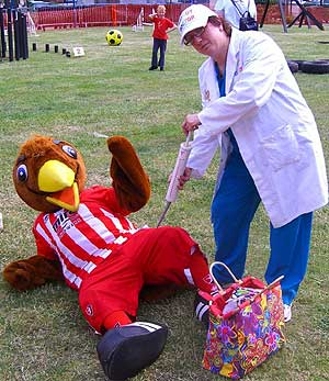 Angela attending to the 'injured' mascots at Milton Kenynes